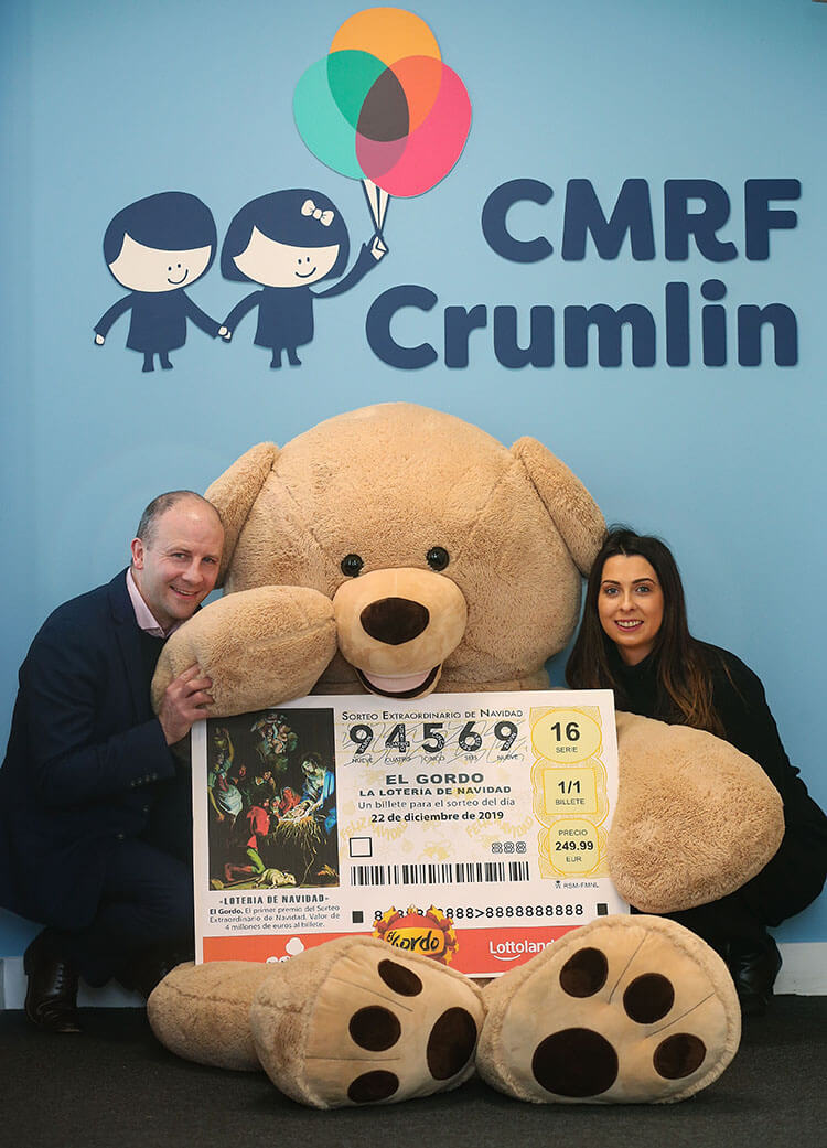 Ireland country manager of Lottoland Graham Ross with a giant teddy bear and holding a large El Gordo ticket